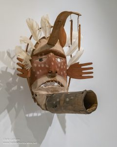 Carved and painted wood Yup'ik Windmaker mask