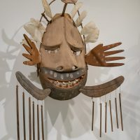 Carved and painted wood Yupik dance mask representing the Keeper of the River's Mouth